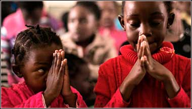 Children praying in South Africa