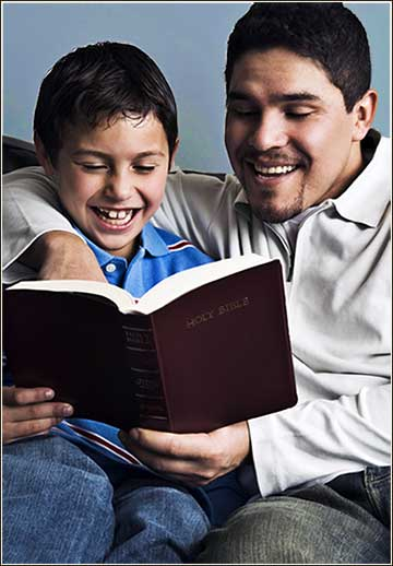 Father son reading Bible