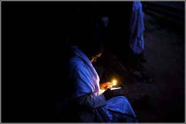 Man praying by candlelight