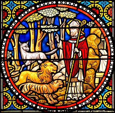 Devotional stained glass of Saint Austremonius taming lions