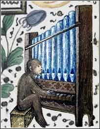 monkey playing a pipe organ, from an illuminated Bible
