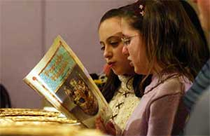 Jewish children learning about Passover
