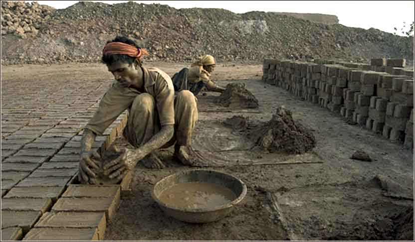 Making mud bricks in India