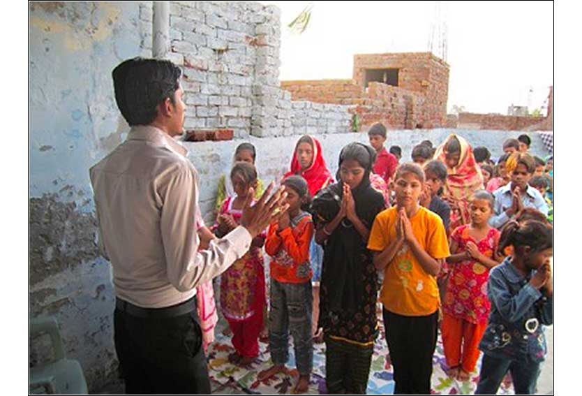 A missionary with <i>Climbing for Christ</i> leads outdoor prayers in Pakistan.