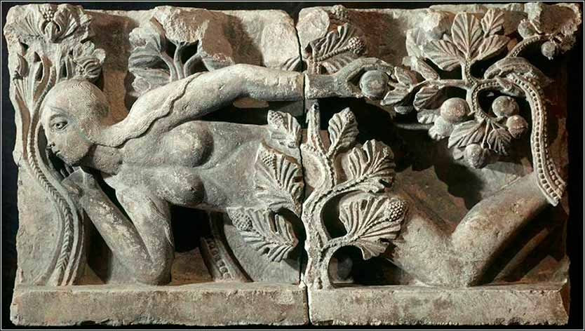 <i>The Temptation of Eve</i>,  by Gielebertus, ca. 1130. This bas-relief is found over the main door of the Cathédrale Saint-Lazare d&rsquo;Autun, Autun, France.