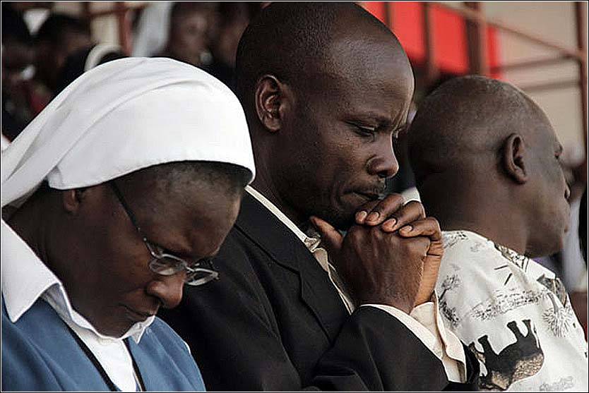 People at prayer in a Kenya Christian mission